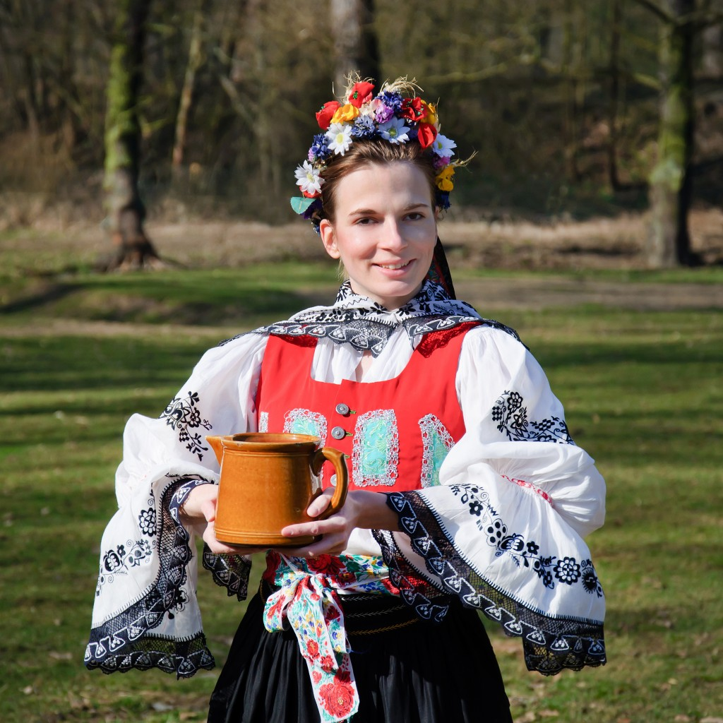 The smiling girl in folk costume